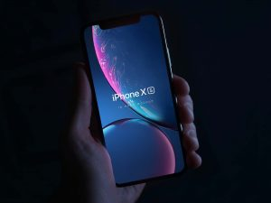 iPhone XS in Hand Mockup